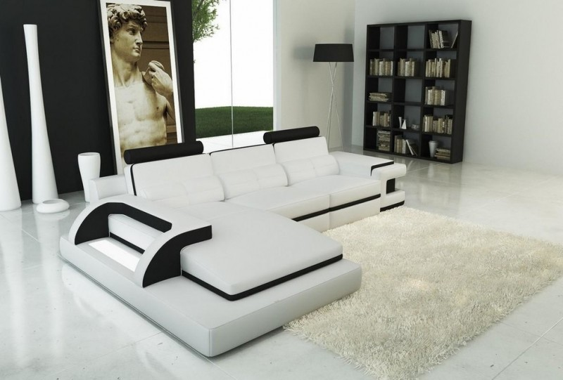 modern living room modern white sectional with additonal chaise fluffy white area rug white floors solid black book rack modern floor lamp with black shade