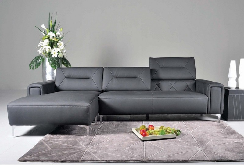 modern minimalist living room idea modern sectional with dark leather finishing adjustable back cushion additional facing chaise solid black side table silver vase