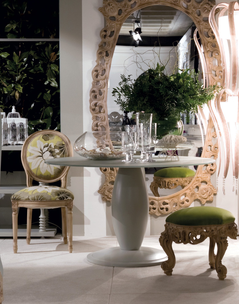 oversized oval mirror with wooden handcrafted details French dining chair round glass top dining table in grey