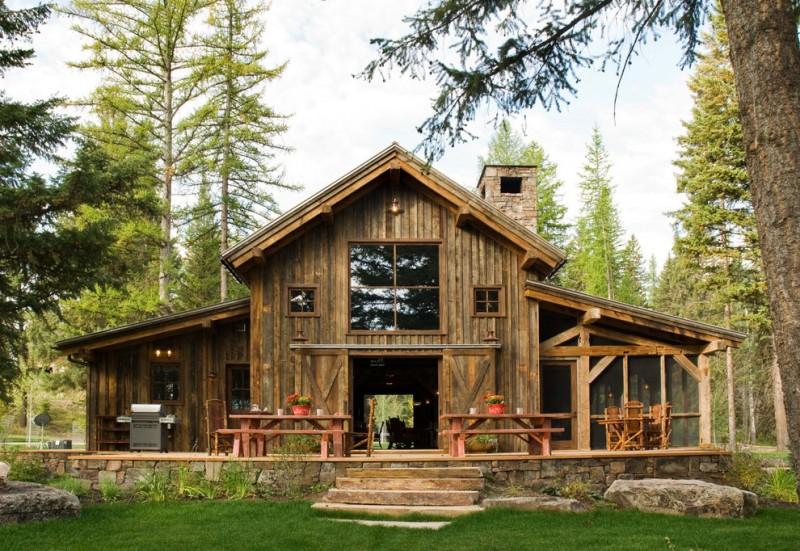 pole barn house plans barn cabin grass lawn patio furniture picnic table porch rustic sliding barn doors stone chimney stone steps turf