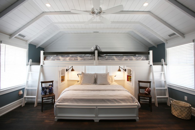 queen size bunk beds white beach style bedroom ladders black wood railing wood flooring windows with shutters fan shelves