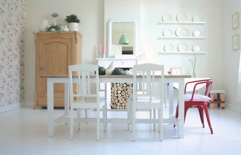 shabby but chic white dining room idea light toned wood corner cabinet white dining chairs wood top dining table red dining chair white open shelves