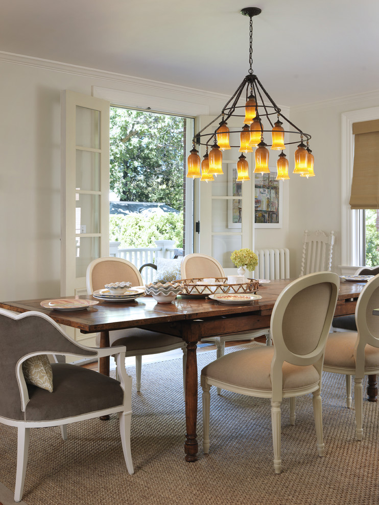 shabby chic dining room neutral & soft French style dining chairs longer hardwood dining table French chandelier juted area rug