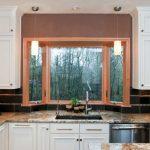 Small Bay Window Brown Trim Granite Countertop White Cabinet Under Mount Sink Ceiling Lights