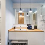 Tiled Wall Blue Pinted Wall Ceiling Lights Wooden Countertop White Vanity Under Mount Sink Wall Mounted Toilet Accent Floor