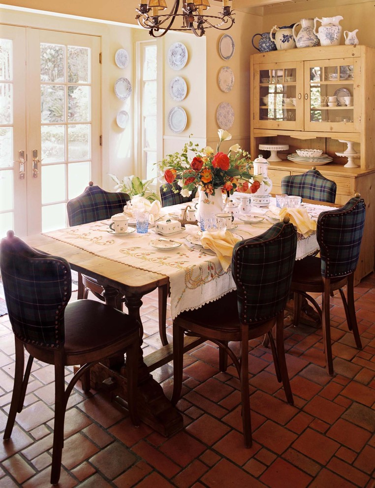 traditional breakfast room French dining chairs with stripped fabrics for back and leather finishing for seat stucco floors wood dining table wood dining cabinet