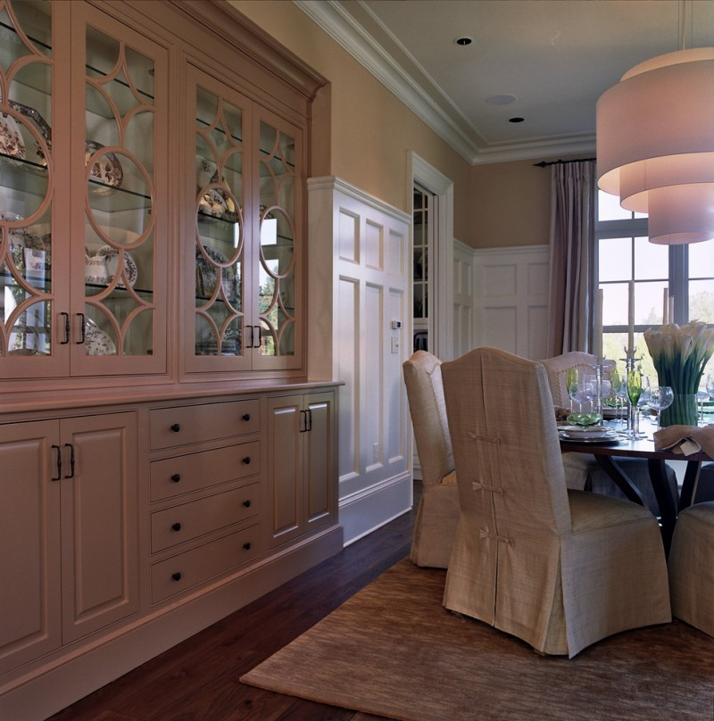 traditional dining room enclosed and recessed corner cabinets in white recessed buffet with decorative framed mirror glass dining chairs with white slipcover