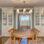 Traditional Dining Room Hardwood Dining Table Hardwood Dining Chairs Medium Toned Hardwood Floors White Built In Corner Cabinets Classic Pendant Lamp With Mini Light Shades