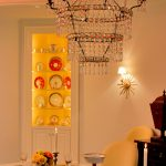 Traditional Dining Room Idea Beige Painted Walls Built In Hutch In White With Glass Door Crystal Chandelier Decorative Wall Lamp