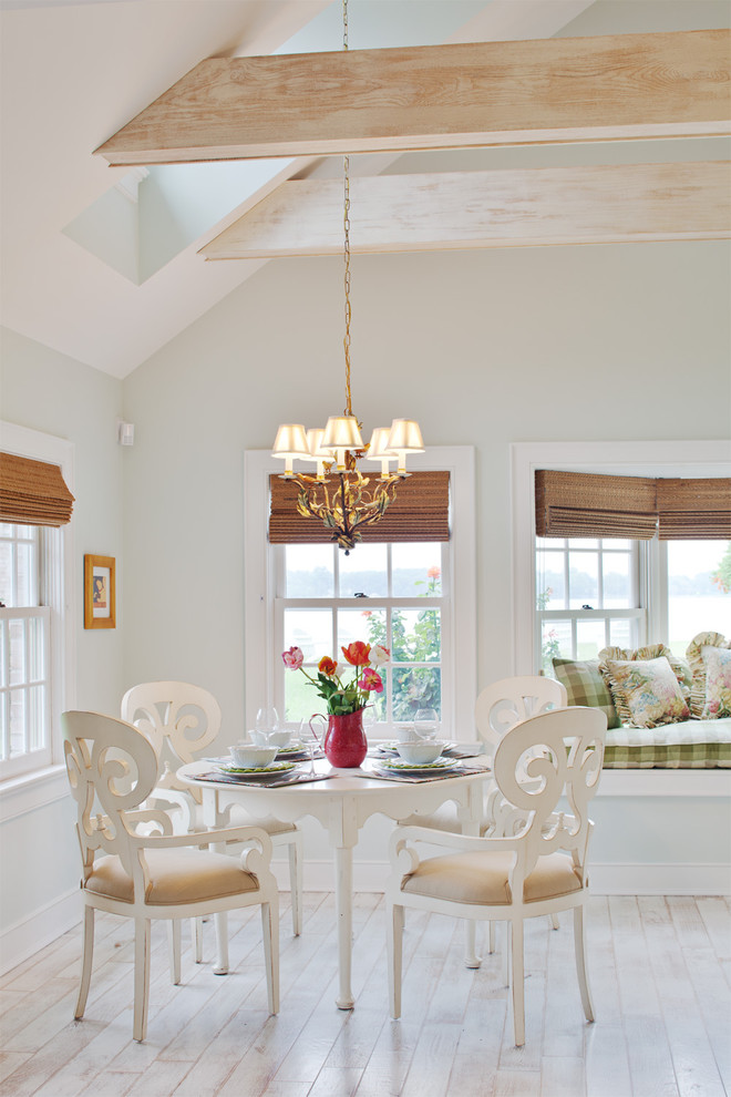 traditional dining room idea white French style dining set with upholstered seatings small sized chandelier with gold toned light whitewashed wood boards floors exposed wood beams