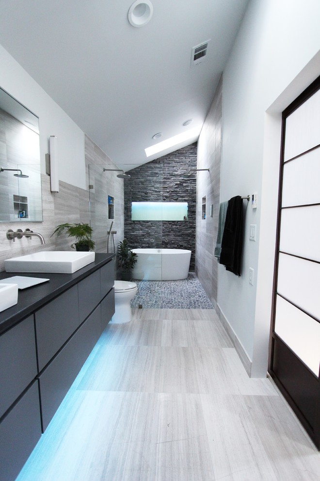 walk in shower designs grey and white bathroom stone wall white tub vaulting ceiling dak grey vanity sinks mirrors towel holder