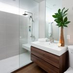 Walk In Shower Designs Integrated Sink Flat Panel Cabinets Dark Wood Cabinets Gray Tiles Square Shower Head Built In Shelves Large Mirror