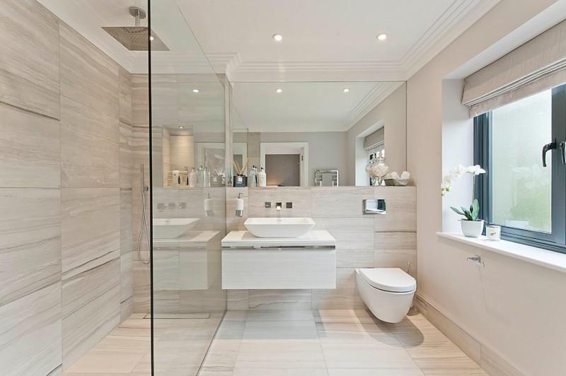 walk in shower designs stainless steel big shower head glass door porcelain wall and floor floating white vanity sink wide mirror window