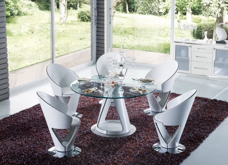 white contemporary dining set with small round glass top table with white center legs and white chairs