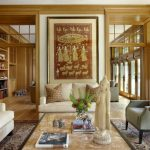 Eclectic Enclosed Living Room With Medium Tone Hardwood Floors Geometric Pillow Throws Indian Painting White And Gray Sofa Wood Trim