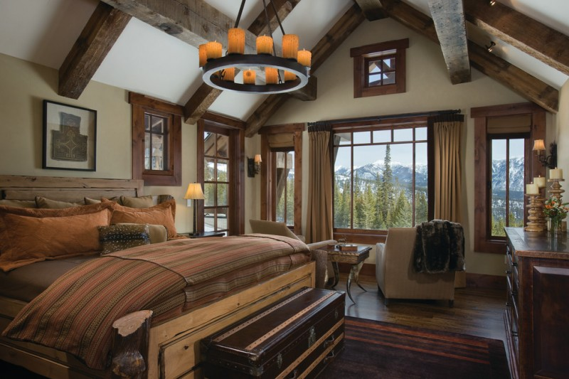 Rustic bedroom idea with beige walls and dark hardwood floors brass pendant lamp brown carpet beige sofa cream curtains wooden cabinet