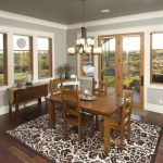 Trendy Dining Room With Gray Walls And Dark Hardwood Floors Wooden Dining Room Table Set And Furniture Pendant Lamp Ceramic Vases In Gray And White