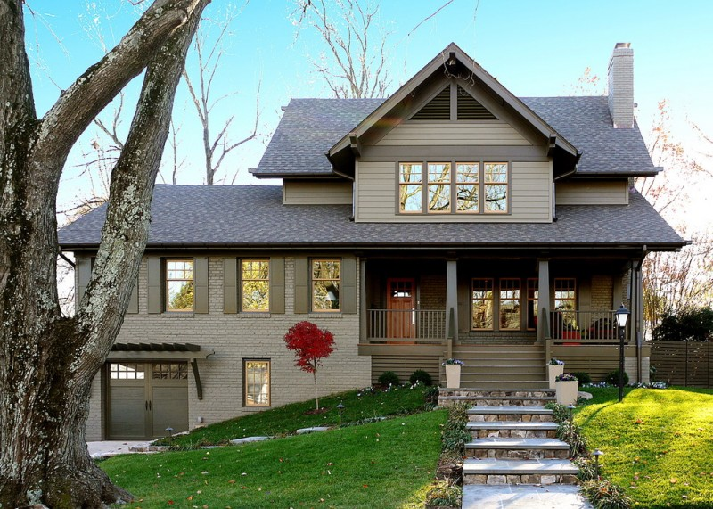arts and crafts gray mixed siding exterior home design with brick wall and slope roofs gray windows, doors, fences, and chimney