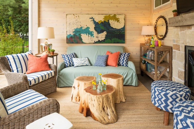 beach style screened patio idea tree trunk stools tree trunk table multicolored ottoman chairs wood colored area rug rattan chairs with stripped mattress colorful throw pillows
