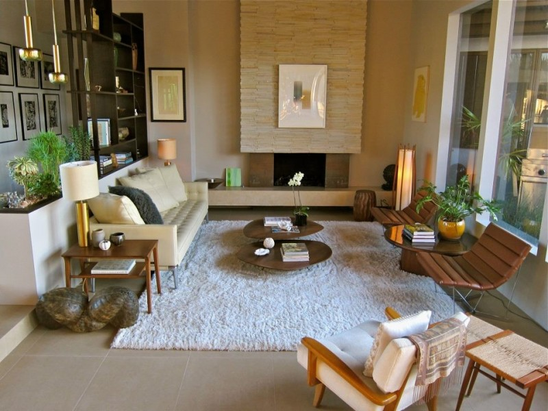 beige loveseat with throw pillows flat & wide coffee tables a pair of wood boards chairs white shag rug wood side tables with table lamps