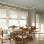 Classic Dining Room With Gray Walls And Light Hardwood Floors Wooden Dining Room Sets With White Chairs Pendant Lamp Gray Carpet