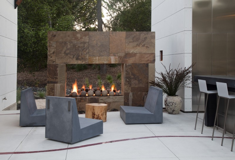 contemporary backyard patio idea contemporary patio chairs in blue raw tree trunk center table unique fire feature with stones surround