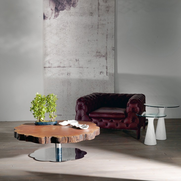 contemporary living room dark purple modern sofa with tufted upholstery round glass top side tables with white base large tree trunk top coffee table with stainless steel base