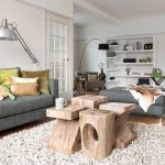 Contemporary Living Room Idea Modern Grey Sectional Sofa Colorful Throw Pillows White Wool Area Rug A Cluster Of Tree Trunk Tables