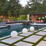 Covered Patio Pavers Modern Pool Waterfall Coping Lounge Chair White Round Ball Hot Tub Space Wooden Siding BBQ Outdoor Spa Area Pendant Lights