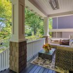 Craftsman Front Porch Idea L Shaped Modern Sectional Glass Top Rectangular Table With Lattice Side Panels Cream Toned Rug With Dark Motifs White Decking Rail System Dark Toned Wood Boards Floors