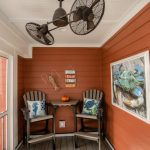 Craftsman Style Porch In Smaller Size Orange Painted Exterior Walls A Pair Of Chairs And Table With Higher Legs Double Ceiling Fans White Painted Porch Ceilings