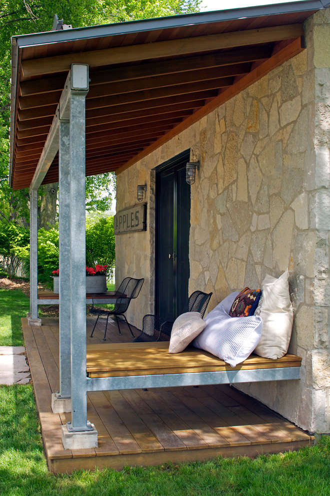 eclectic front porch idea floating wood daybed a pile of accent pillows natural stone exterior walls wood board floors without finishing