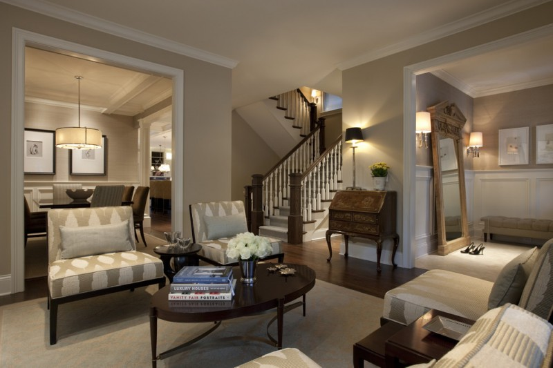 large classic living room with beige walls and brown floors wooden coffee table gray geometric print sofas white trim cream carpet