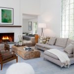 Light Grey Sectional With Facing Chaise White Blanket A Couple Of Chairs With Wood Construction Unfinished Tree Trunk Coffee Table Light Grey Area Rug