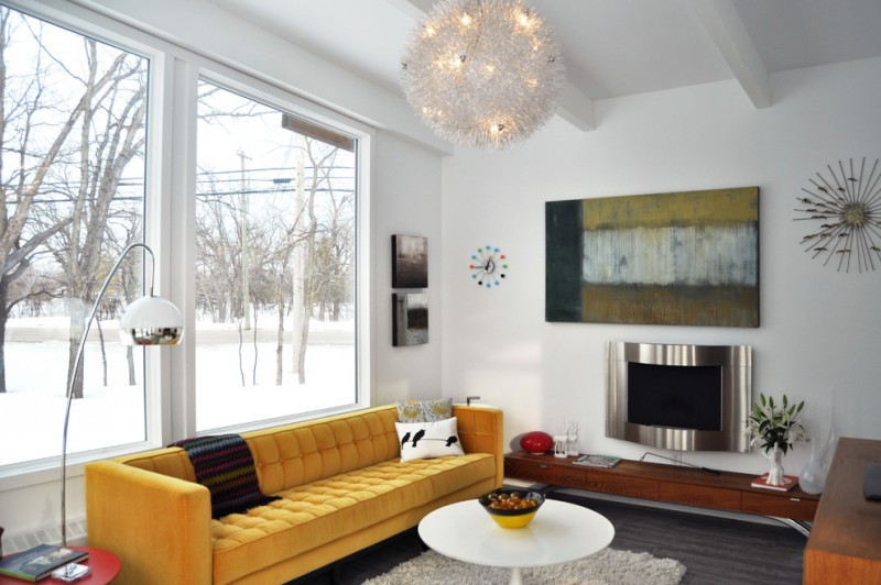 mid century living room with modern style yellow sofa with dark blanket and multicolored throw pillows round top coffee table in white