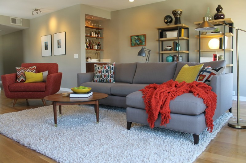 mid century modern living room grey sectional sofa vintage style chair in red white shag rug red blanket modern bookcases mini wine racks