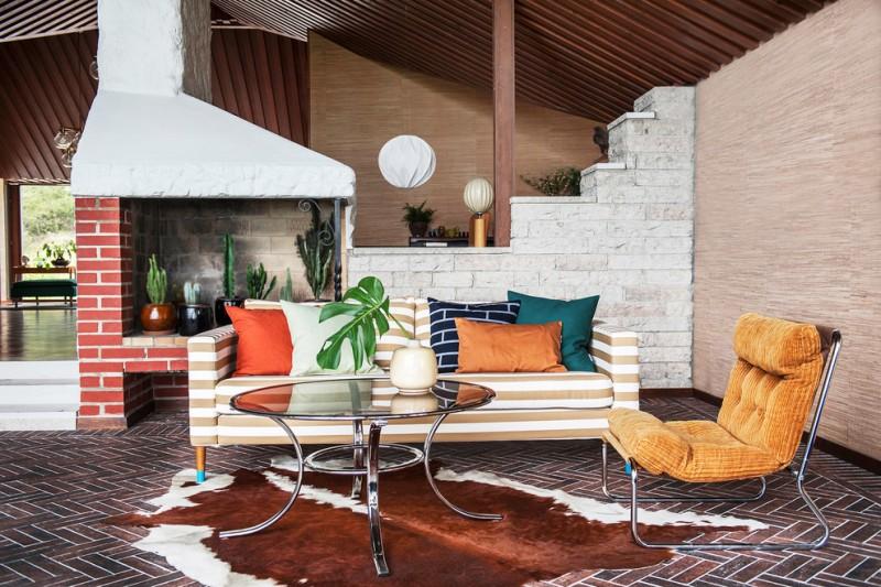 mid century modern mix retro vibes living room set cowhide rug terracotta floors