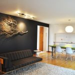 Mid Century Modern Sofa Finished In Black Doff And Orange Detail Black Doff Walls White Shag Rug Medium Toned Wood Floors