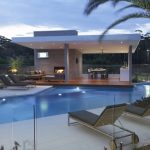 Modern Pool Open Patio Wooden Deck Lounge Chair Recessed Lights Dining Area Concrete Tiles Palm Tree