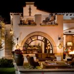 Patio Firepit Sofa Ceramic Pot Arched Way Stairs Balcony Wall Sconce Lanterns Roof Tiles Flowering Courtyard