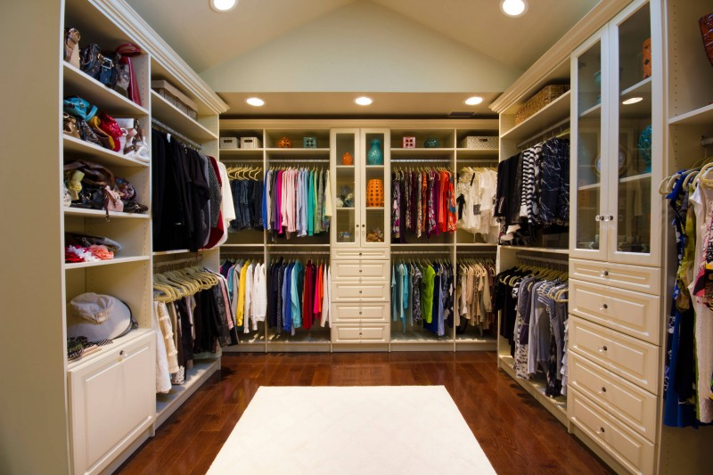 recessed lights white cabinet built in cabinet glass front cabinet open shelves wooden floor white carpet sloped ceiling