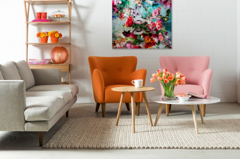 retro & mid century modern living room orange armchair pink armchair grey sectional sofa wood top center table in round shape round shaped white top center table