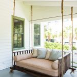 Traditional Front Porch Idea Dark Finishing Swinging Daybed Peach Toned Mattress And Blusters Soft Colored Throw Pillows