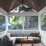 Traditional Front Porch With Screen Dark Toned Wood Board Ceilings Corner Sofa In Modern Design Brown Accent Pillows Wood Center Table Wood Boards Floors