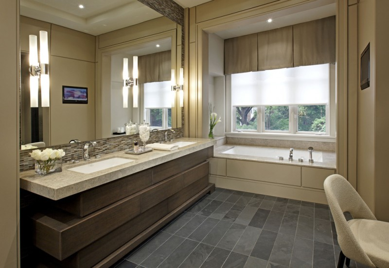Large contemporary master beige tile slate floor bathroom with an undermount sink, an undermount tub, dark wood cabinets, beige walls and granite countertops