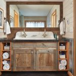 Rustic Bathroom Remodel With A Trough Sink Wooden Door Less Cabinets White Painted Wooden Deck Walls Rectangular Mirror Granite Tiles Floor