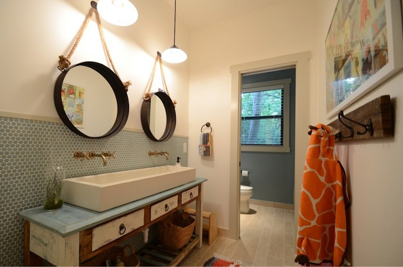 Transitional bathroom with a trough sink and double circular mirrors hanging lamps blue mosaic tiles wall beige ceramic tiles floor