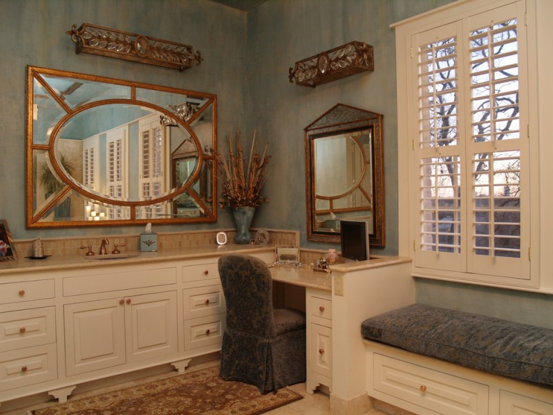 brown marble top with white cabinet with brown marble top makeup counter in the corner with copper framed mirror