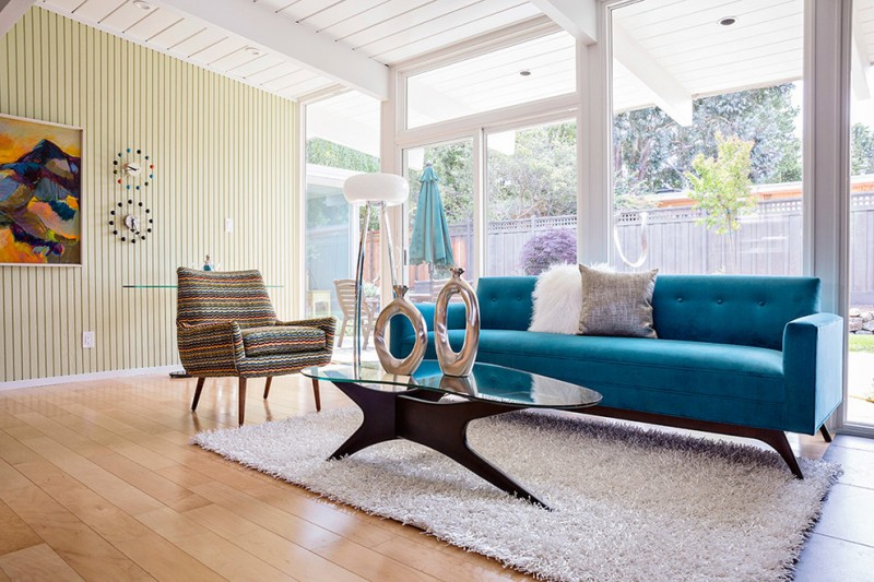 long warm blue midcentury sofa and warm stripped couch