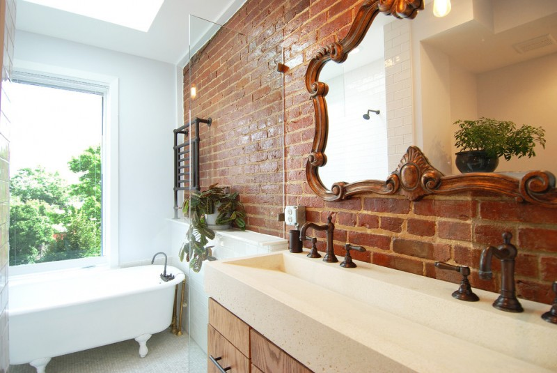 mid sized transitional master bathroom with flat panel cabinets, medium tone wood cabinets, gray walls and a trough sink brick wall mosaic floor tiles